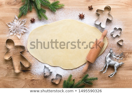 Baking for Christmas, rolled out dough with cookie Stock photo © joannawnuk