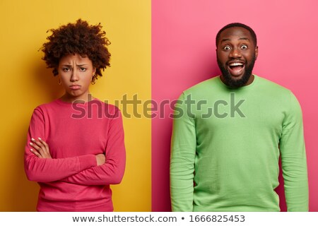 Joyful unshaven male with happy expression, giggles at funny joke, closes eyes with pleasure, dresse Stock photo © vkstudio