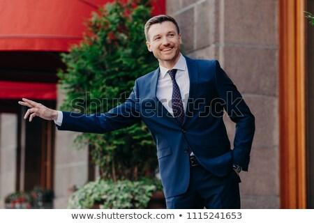 Horizontaal shot gelukkig mannelijke manager gebaar Stockfoto © vkstudio