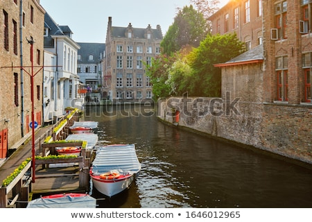 Bruges canal and houses at sunset. Brugge famous place, Belgium Stock photo © dmitry_rukhlenko