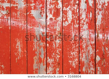 Red flaky paint on a wooden fence. Stock photo © latent
