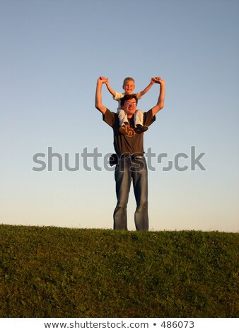 father with son on shoulders on sundown Stock photo © Paha_L
