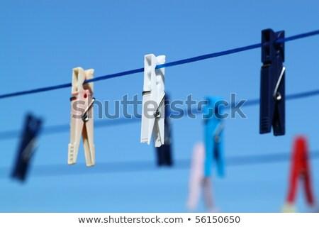 Cloth Pegs Under The Clear Blue Sky Zdjęcia stock © Artush