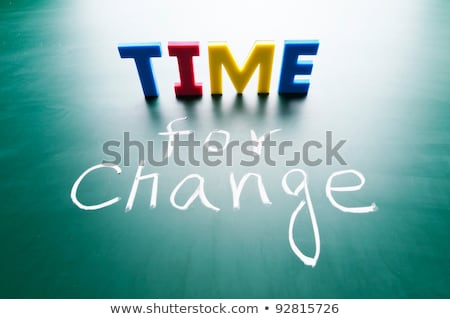 time for change colorful words on blackboard stock photo © bbbar