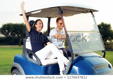 Couple in golf buggy Stock photo © photography33