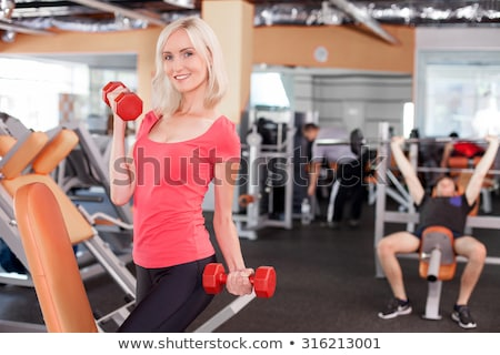 a woman raising a dumbbell Stock photo © photography33