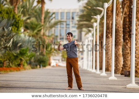 cheerful man jumping on the beach laughing landscape stock photo © juniart