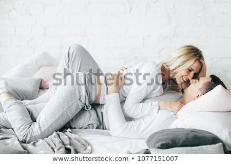 Portré pár ágy férfi hálószoba mosolyog Stock fotó © photography33