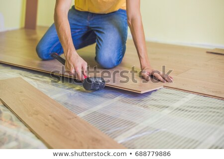 Man renovating the floor with a hammer Stock photo © photography33