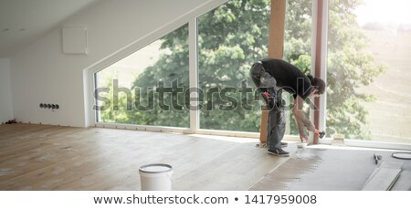 joiner laying floorboard Stock photo © photography33