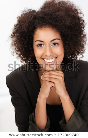 Portrait of pretty young businesswoman with hand on chin and smi Stock photo © rozbyshaka