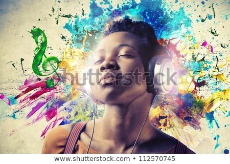 Lány hallgat zene gyönyörű fiatal diák Stock fotó © kyolshin