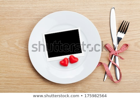Valentine's Day blank photo frame over plate and silverware Stock photo © karandaev