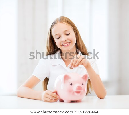 Dinheiro piggy bank adolescente financiar feminino Foto stock © monkey_business