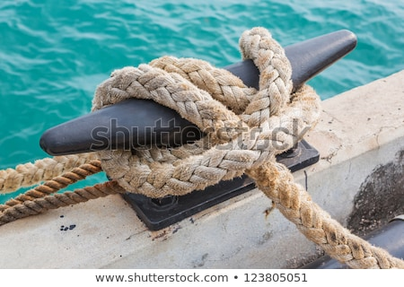 green rope on the mooring bollard stock photo © marekusz