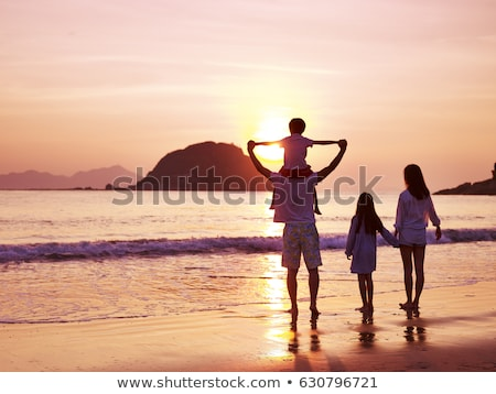 Iki çocuklar ayakta plaj izlerken gündoğumu Stok fotoğraf © Yongkiet