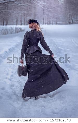 portrait of retro woman in vintage dress wearing hat stock photo © feelphotoart