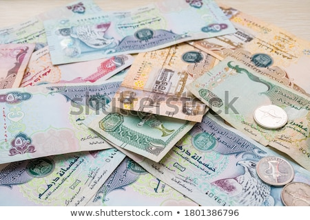 Different Dirham  banknotes from Emirates on the table Stock photo © CaptureLight