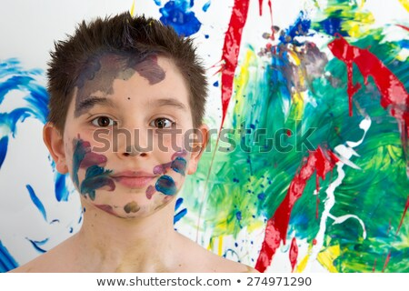 handsome young boy daubed with colorful paint stock photo © ozgur