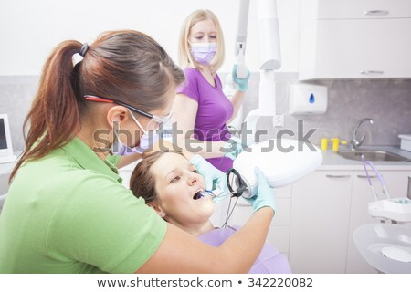 Dentist taking an xray of patients mouth Stock photo © wavebreak_media