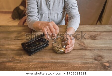 Happy woman counting money Stock photo © deandrobot