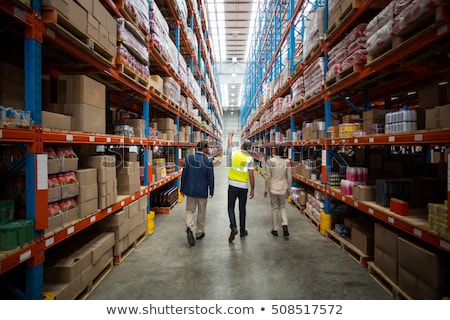 Сток-фото: Rear View Of Manager In Warehouse