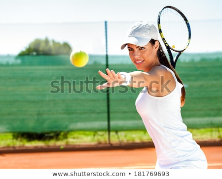 attractive woman playing tennis stock photo © deandrobot