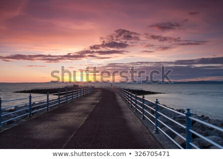 sunset on the pier in morecambe stock photo © capturelight