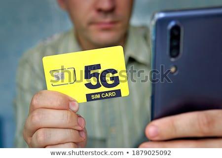 Switching SIM cards in mobile smartphone Stock photo © stevanovicigor