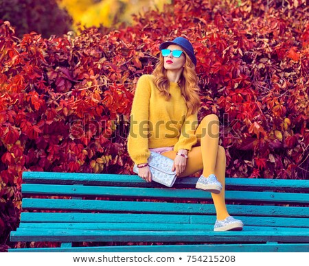 beautiful fashion model with yellow jumper sitting stock photo © denismart