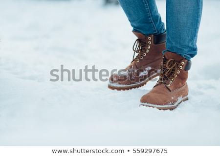Człowiek zimą buty stałego śniegu górę Zdjęcia stock © stevanovicigor