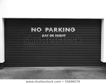 garage door with no parking sign stock photo © stevanovicigor