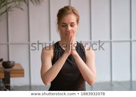 Idős emberek meditál csukott szemmel ima pozició Stock fotó © wavebreak_media