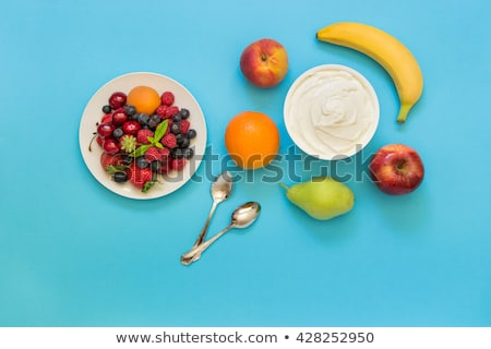 container with strawberry yogurt and spoon top view isolated o stock photo © tanach