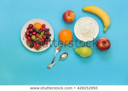 Contenant fraise yogourt cuillère haut vue Photo stock © TanaCh