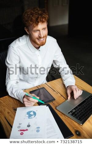 portret · knap · jonge · man · werken · laptop · freelance - stockfoto © deandrobot