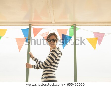 Woman looking to camera past bunting Stock photo © IS2