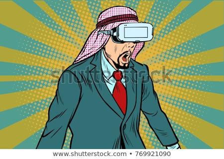 Surprised Arab businessman in VR glasses Stock photo © studiostoks
