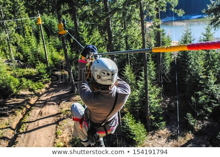 Girl on Zip Line stock photo © FOTOYOU