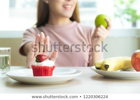 woman refuses a sweet cake Stock photo © studiostoks