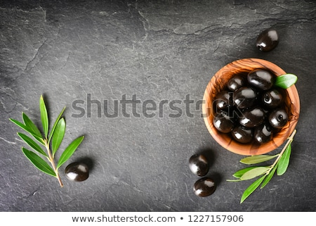 Stick with olive and bowl with green olives stock photo © Melnyk