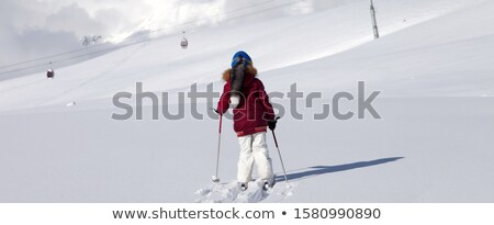 Girl on skis in off-piste slope with new fallen snow at nice day Stock photo © BSANI