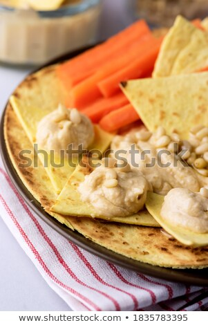 Plate of corn chips with nuts Stock photo © dash