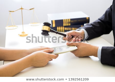 Lawyer being offered receiving money as bribe from client at des Stock photo © snowing