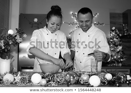 happy young friends loving couple chefs on the kitchen cooking stock photo © deandrobot