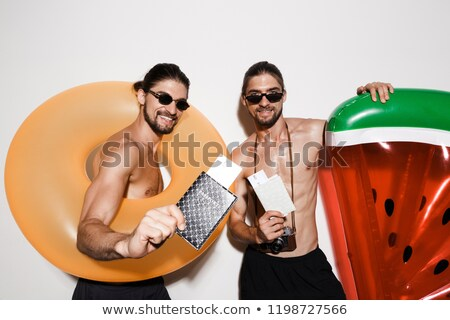Portrait of a two cheerful muscular shirtless twin brothers Stock photo © deandrobot