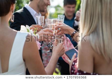 bruidegom · kus · bruid · kerk · bloemen · bruiloft - stockfoto © nruboc