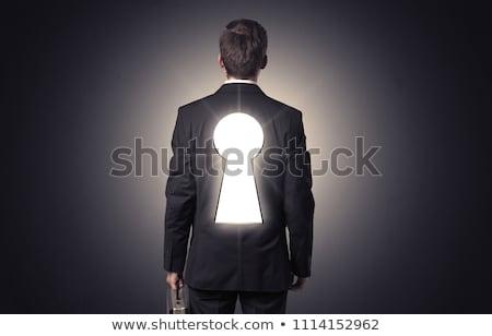 Empresário em pé buraco de fechadura de volta jovem pensando Foto stock © ra2studio