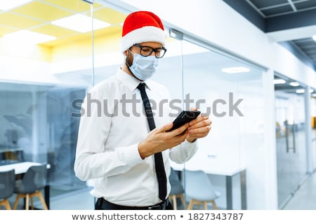 happy man in santa hat and suit at christmas Stock photo © dolgachov