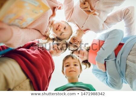Schoolkinderen leraar naar beneden te kijken camera kinderen onderwijs Stockfoto © Kzenon